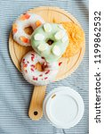 coffee and donut top view | Shutterstock . vector #1199862532