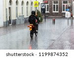 picture of a motorbike rider on ... | Shutterstock . vector #1199874352