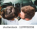 couple kissing in car. road... | Shutterstock . vector #1199950558