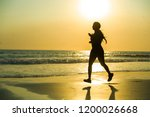 silhouette of young happy and... | Shutterstock . vector #1200026668