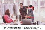 two fashion designers are... | Shutterstock . vector #1200120742
