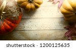 pumpkin on wooden background ... | Shutterstock . vector #1200125635
