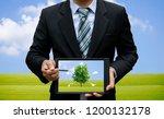 men holding touch screen tablet ... | Shutterstock . vector #1200132178