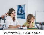 a bored child refusing to... | Shutterstock . vector #1200155335