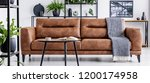 table in front of leather couch ... | Shutterstock . vector #1200174958