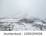 old lava field in snow. top of... | Shutterstock . vector #1200194038