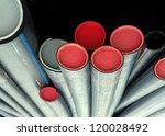 Low angle view of stack of plastic pipes - stock photo