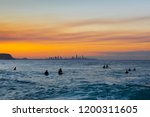 surfers in the ocean with a... | Shutterstock . vector #1200311605