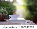 white cup with plant and... | Shutterstock . vector #1200347578
