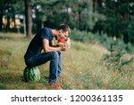 young odd strange man eating...   Shutterstock . vector #1200361135