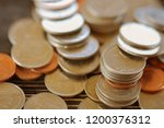 row of coins on wood background ... | Shutterstock . vector #1200376312