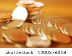 row of coins on wood background ... | Shutterstock . vector #1200376318