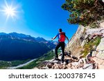 hiker takes a rest observing a... | Shutterstock . vector #1200378745