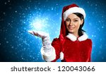 Portrait of beautiful girl wearing santa claus clothes on red background - stock photo