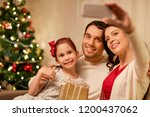 holidays  family and technology ... | Shutterstock . vector #1200437062