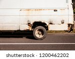rusty minibus stands on the road | Shutterstock . vector #1200462202