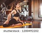 woman doing bending legs yoga... | Shutterstock . vector #1200492202