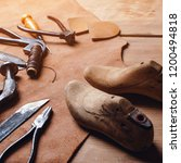 leather craft tools on wooden... | Shutterstock . vector #1200494818