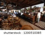 the long bar in the raffles... | Shutterstock . vector #1200510385