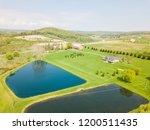 aerial of farmland and farm... | Shutterstock . vector #1200511435