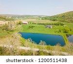 aerial of farmland and farm... | Shutterstock . vector #1200511438