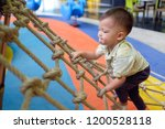 cute little asian 2 years old... | Shutterstock . vector #1200528118