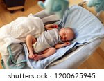 Adorable Newborn Boy Sleeping...