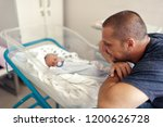 tender moment between a father... | Shutterstock . vector #1200626728