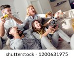 group of young friends sitting... | Shutterstock . vector #1200631975