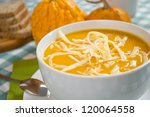 pumpkin soup in a white plate... | Shutterstock . vector #120064558