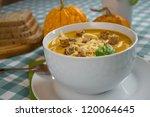 pumpkin soup in a white plate... | Shutterstock . vector #120064645