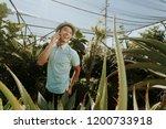 cheerful man talking on the...   Shutterstock . vector #1200733918