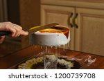 cook preparing mousse cake... | Shutterstock . vector #1200739708