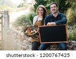 Farmers Holding A Blackboard...