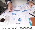 bisinessman working his job at... | Shutterstock . vector #1200806962