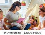preschool teacher reading a... | Shutterstock . vector #1200854008