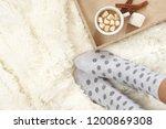 woman feet in polka dot socks... | Shutterstock . vector #1200869308