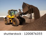 Small photo of Bulldozer working on manganese in bulk wheel loader