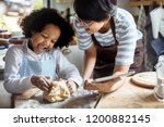 young boy leaning to bake with... | Shutterstock . vector #1200882145
