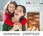winter portrait of happy loving ... | Shutterstock . vector #1200976102