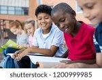 multiethnic children sitting in ... | Shutterstock . vector #1200999985