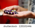 Close-up of hands of woman taking a bracelet in a jewelry store - stock photo