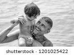 baby playing with father in the ... | Shutterstock . vector #1201025422