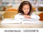 young school girl reading a... | Shutterstock . vector #120103876