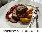 grilled pork medallions with... | Shutterstock . vector #1201052218