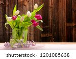 bouquet of tulips on a wooden... | Shutterstock . vector #1201085638