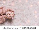 cozy background. hands holding...   Shutterstock . vector #1201089598