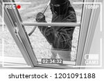 Cctv View Of Burglar Breaking...