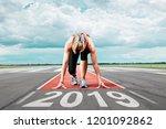 female runner waits for her... | Shutterstock . vector #1201092862