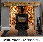 wood burning stove on slate... | Shutterstock . vector #1201094248